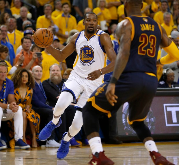 Golden State Warriors' Kevin Durant (35) dribbles against Cleveland Cavaliers' LeBron James (23) in the second quarter of Game 1 of the NBA Finals at Oracle Arena in Oakland, Calif., on Thursday, June 1, 2017. (Nhat V. Meyer/Bay Area News Group)