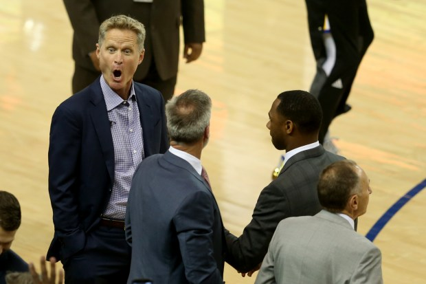 The Golden State Warriors head coach Steve Kerr reacts as he greets fans from a distance before the tipoff against the Cleveland Cavaliers in Game 2 of the NBA Finals at Oracle Arena in Oakland, Calif., on Sunday, June 4, 2017. (Ray Chavez/Bay Area News Group)