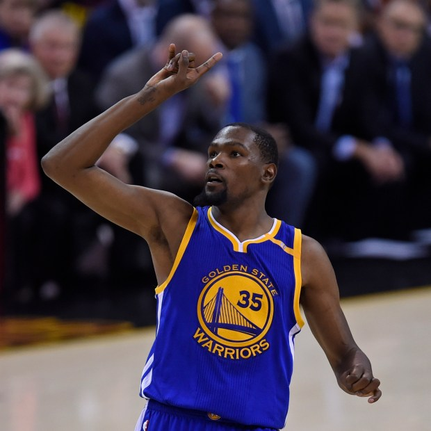 Golden State Warriors' Kevin Durant (35) gestures after shooting a 3-point basket against the Cleveland Cavaliers during the fourth quarter of Game 3 of the NBA Finals at Quicken Loans Arena in Cleveland, Ohio, on Wednesday, June 7, 2017. The Golden State Warriors defeated the Cleveland Cavaliers 118-113. (Jose Carlos Fajardo/Bay Area News Group)