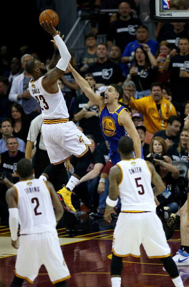 Cleveland Cavaliers' LeBron James (23) takes a shot against Golden State Warriors' Klay Thompson (11) in the third quarter of Game 4 of the NBA Finals at Quicken Loans Arena in Cleveland, Ohio, on Friday, June 9, 2017. (Nhat V. Meyer/Bay Area News Group)