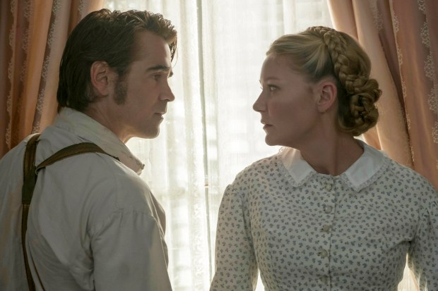 "This image released by Focus Features shows Colin Farrell, left, and Kirsten Dunst in a scene from ""The Beguiled."" (Ben Rothstein/Focus Features via AP)"