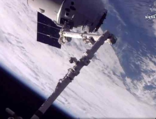 In this frame from NASA TV, a SpaceX Dragon arrives at the International Space Station on Monday, June 5, 2017, making an unprecedented second trip to the orbiting outpost. The Dragon supply ship, recycled following a 2014 flight, was launched from Florida on Saturday. (NASA TV via AP)