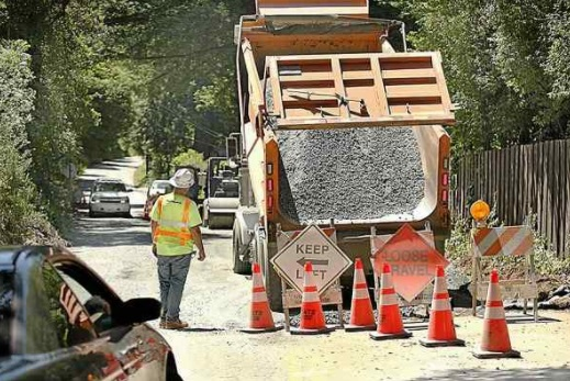 Graniterock crews contracted by the county are working to reopen Laurel Glen Road damaged by a slide during the winter storms. The work, which started May 17, will run through June 7. (Dan Coyro — Santa Cruz Sentinel)