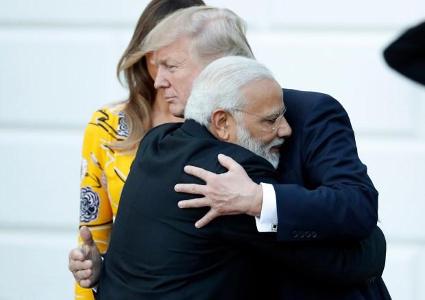 Indian Prime Minister Narendra Modi hugs President Donald Trump as Modi departs the White House, June 26, 2017. (AP Photo/Alex Brandon, File)