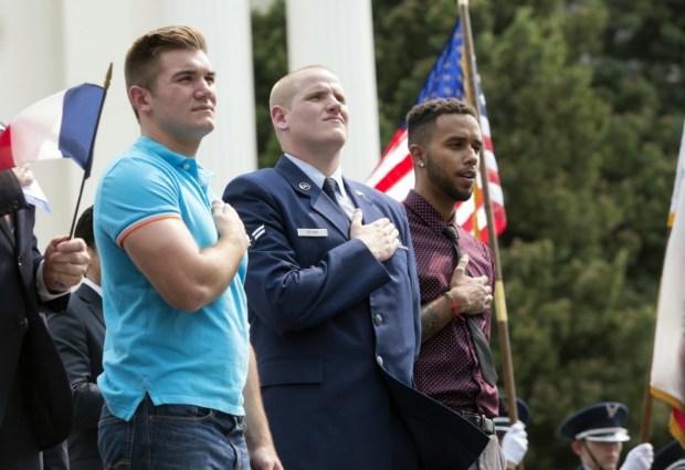 Oregon National Guardsman Alek Skarlatos, left, U.S. Airman Spencer Stone, center, and Anthony Sadler attend a parade in Sacramento, on Sept. 11, 2015. (Carl Costas/AP)