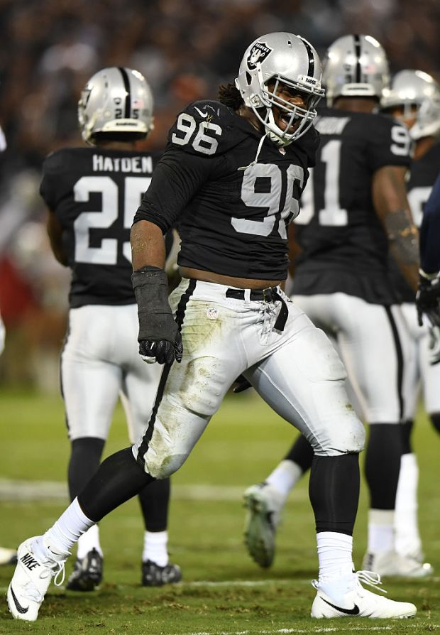 OAKLAND, CA - NOVEMBER 06: Denico Autry #96 of the Oakland Raiders celebrates a tackle against the Denver Broncos at Oakland-Alameda County Coliseum on November 6, 2016 in Oakland, California. (Photo by Thearon W. Henderson/Getty Images)
