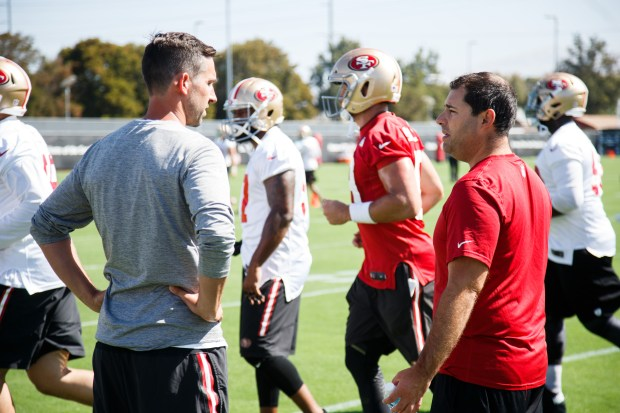 San Francisco 49ers head coach, Kyle Shanahan, left, and CEO Jed York, talk during the team's training camp in Santa Clara, California on July 28, 2017. (Dai Sugano/Bay Area News Group)