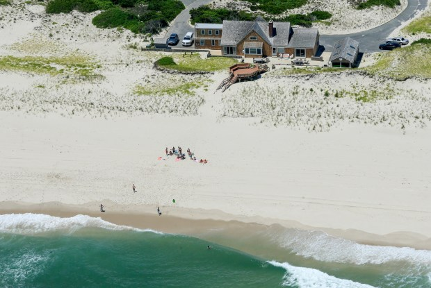 New Jersey Gov. Chris Christie uses the beach with his family and friends at the governor's summer house at Island Beach State Park in New Jersey. (Andrew Mills/NJ Advance Media via AP)