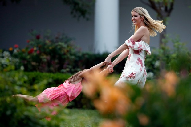 Ivanka Trump, the daughter and assistant to President Donald Trump, swings her daughter Arabella Kushner in the Rose Garden at the Congressional Picnic on the South Lawn of the White House, Thursday, June 22, 2017, in Washington. (AP Photo/Alex Brandon)