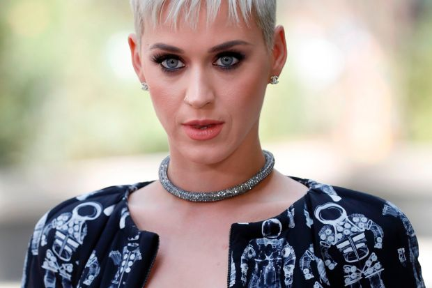 US singer Katy Perry poses during the photocall before Chanel 2017-2018 fall/winter Haute Couture collection show in Paris on July 4, 2017. / AFP PHOTO / Patrick KOVARIKPATRICK KOVARIK/AFP/Getty Images
