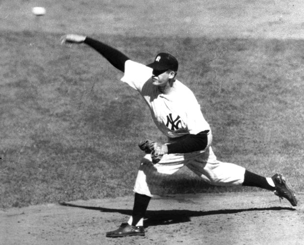 FILE--New York Yankees pitcher Don Larsen pitches during the fourth inning of his perfect game against the Brooklyn Dodgers in Game 5 of the 1956 Series Oct. 8, 1956. On a day Don Larsen was celebrated at Yankee Stadium, David Cone pitched a perfect game of his own. Cone dazzled the Montreal Expos with a wide assortment of pitches Sunday, throwing the 14th perfect game in modern baseball history to lead the Yankees to a 6-0 victory. (AP Photo)