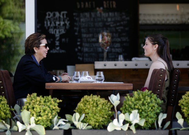 Barbie Koch and Alison Koch converse on the outdoor sitting at the Rootstock Wine Bar in Main Street Cupertino, in California, on Thursday, July 20, 2017. (JosieLepe/Bay Area News Group)