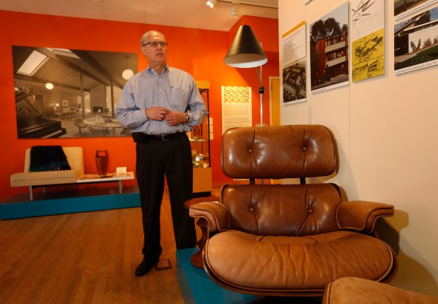 "Steven Eichler, the grandson of developer Joseph Eichler, looks over the latest exhibition at the Los Altos History Museum: ""Eichler Homes: Modernism for the Masses"" at Los Altos History Museum in Los Altos, California, Tuesday, July 18, 2017. In foreground is an Eames chair that is in the family collection. (Patrick Tehan/Bay Area News Group)"