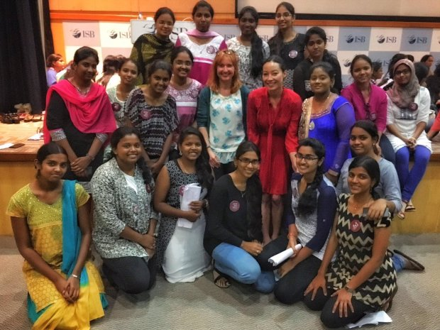 Girls in Tech founder and CEO Adriana Gascoigne (red dress) withparticipants in a Girls in Tech 'Startup Success Factors Boot Camp' in India (courtesy of Girls in Tech)