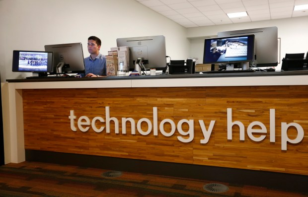 Daniel Jensen works at the technology help desk at the Santa Clara University Learning Commons and library in Santa Clara, California, on Friday, July 7, 2017. Universities throughout California have been reshaping the services they offer as coursework moves away from textbooks to online sources. (Gary Reyes/ Bay Area News Group)