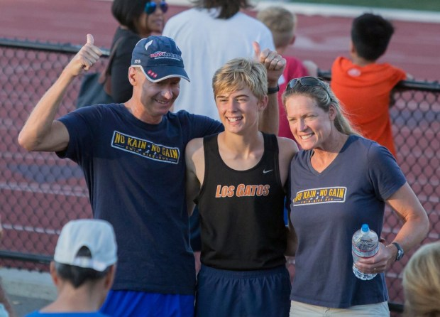 Jeremy Kain poses between his parents, Peter, left, and Shari, after a race. (Courtesy of Ed Crane)