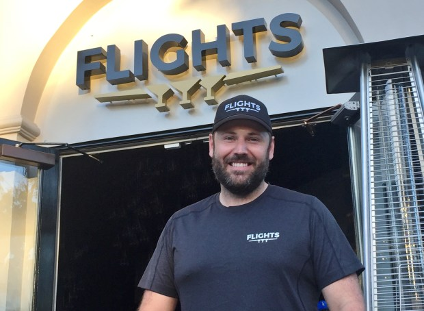 Alexander Hult stands in front of Flights, the restaurant and bar he owns in downtown Campbell, on Tuesday, July 11, 2017.