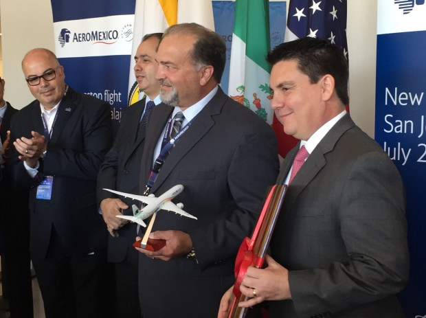 John Aitken, San Jose's interim aviation director, left, exchanges gifts with Jorge Goytortua, Aeromexico's senior vice president for global sales, at an event celebrating new non-stop service between San Jose and Guadalajara, Mexico, on Wednesday, July 12, 2017.
