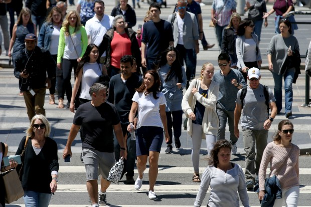 Pedestrians cross the Embarcadero as they walk along Market Street in San Francisco, Calif., on Friday, July 14, 2017. San Francisco tops the list of having the most walkers in California with an average of 6,496 steps per day according to a recent Stanford study. (Anda Chu/Bay Area News Group)