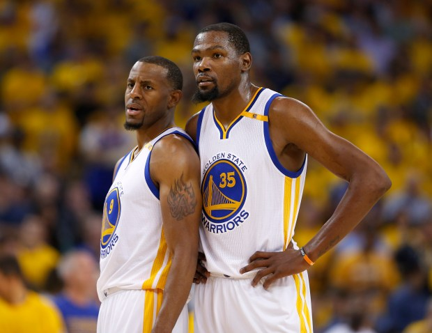 Golden State Warriors' Kevin Durant (35) talks to Golden State Warriors' Andre Iguodala (9) during their game against the Cleveland Cavaliers in the second quarter of Game 5 of the NBA Finals at Oracle Arena in Oakland, Calif., on Monday, June 12, 2017. (Nhat V. Meyer/Bay Area News Group)