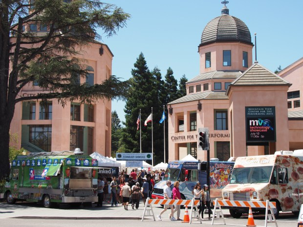 Food trucks are tastefully arranged at the Mountain View Civic Plaza on Wednesday, July 12, 2017, during the city's third annual Technology Showcase. More than a thousand people showed up for the event, at which dozens of tech companies showed off their goods. (Shonda Ranson / City of Mountain View)