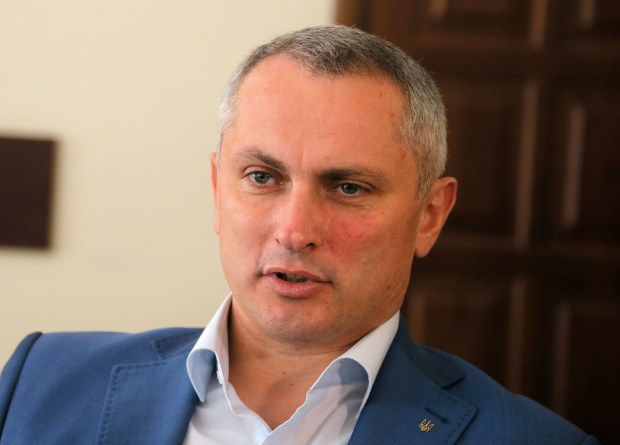 Col. Serhiy Demydiuk, the head of Ukraine's national CyberPolice unit talks during an interview with the Associated Press in his office in Kiev, Ukraine, Monday, July 3, 2017. The small Ukrainian tax software company that is accused of being the patient zero of a damaging global cyberepidemic is under investigation and will face charges, Col. Serhiy Demydiuk suggested Monday. (AP Photo/Efrem Lukatsky)