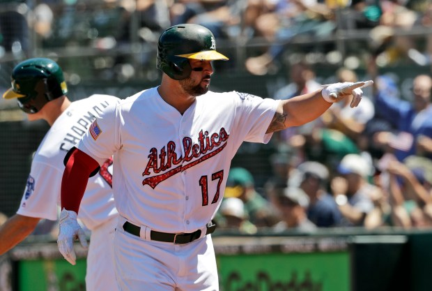 Oakland Athletics' Yonder Alonso points to the dugout after hitting a two-run home run against the Chicago White Sox in the fifth inning of a baseball game Tuesday, July 4, 2017, in Oakland, Calif. (AP Photo/Marcio Jose Sanchez)