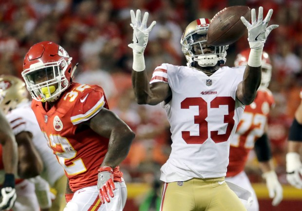 San Francisco 49ers cornerback Rashard Robinson (33) intercepts a pass by Kansas City Chiefs quarterback Tyler Bray (9), with running back Spencer Ware (32) looking, during the first half of an NFL preseason football game in Kansas City, Mo., Friday, Aug. 11, 2017. (AP Photo/Charlie Riedel)