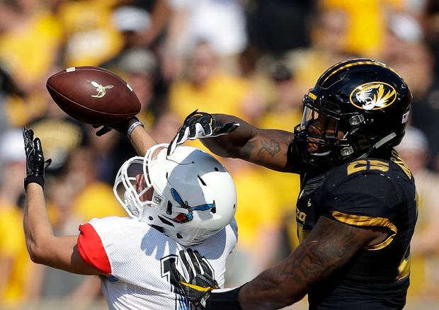 COLUMBIA, MO - SEPTEMBER 24: Linebacker Donavin Newsom #25 of the Missouri Tigers breaks up a pass intended for wide receiver Mason Rutherford #18 of the Delaware State Hornets during the game at Faurot Field/Memorial Stadium on September 24, 2016 in Columbia, Missouri. (Photo by Jamie Squire/Getty Images)