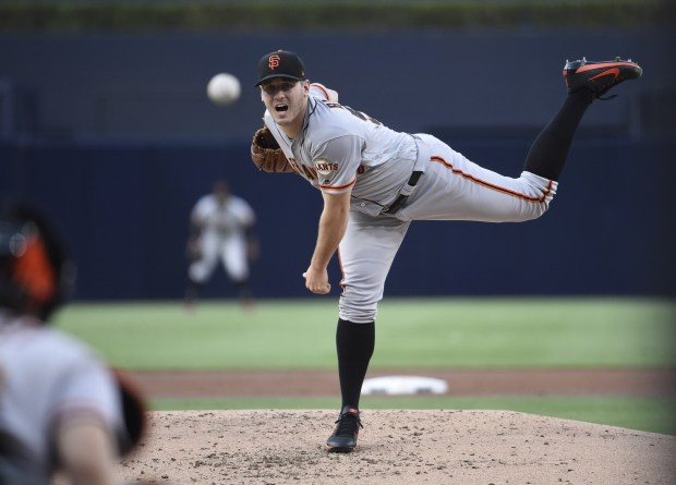 SAN DIEGO, CA - AUGUST 30: Ty Blach #50 of the San Francisco Giants pitches during the first inning of a baseball game against the San Diego Padres at PETCO Park on August 30, 2017 in San Diego, California. (Photo by Denis Poroy/Getty Images)