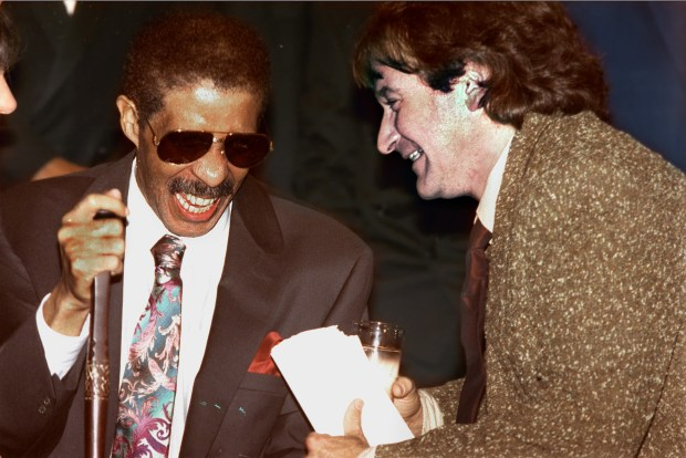 Comedians Richard Pryor, left, and Robin Williams share a laugh at the New York Friar's club in a Friday Sept. 27, 1991 photo. (AP Photo/Andrew Savulich, file)