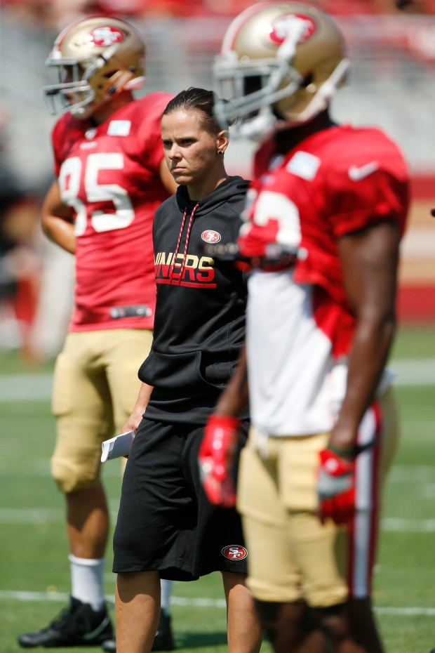 Katie Sowers, 49ers coaching intern, observes San Francisco 49ers practice at Levi's Stadium on Saturday, Aug. 5, 2017, in Santa Clara, Calif. (Jim Gensheimer/Bay Area News Group)
