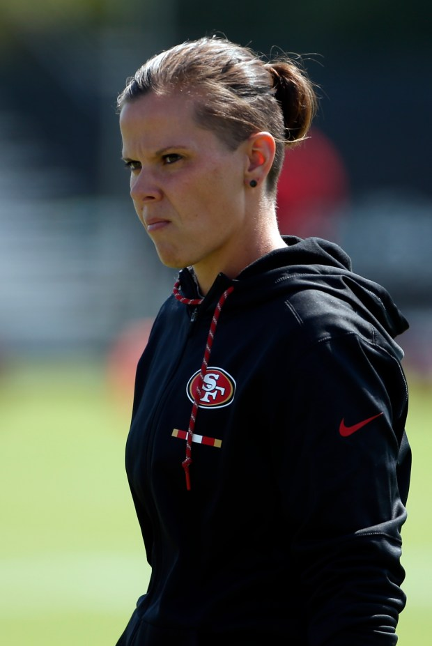 Katie Sowers, a coaching intern for the San Francisco 49ers, keeps an eye on training camp in Santa Clara, California, Tuesday, Aug. 8, 2017. (Karl Mondon/Bay Area News Group)