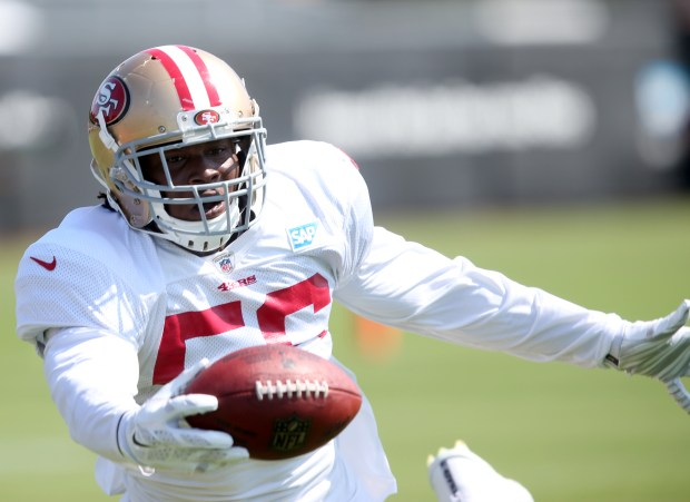 San Francisco 49ers' Reuben Foster (56) intercepts a pass intended for Denver Broncos' Jamaal Charles (28) at practice during training camp at Levi's Stadium in Santa Clara, Calif., on Wednesday, Aug. 16, 2017. (Anda Chu/Bay Area News Group)