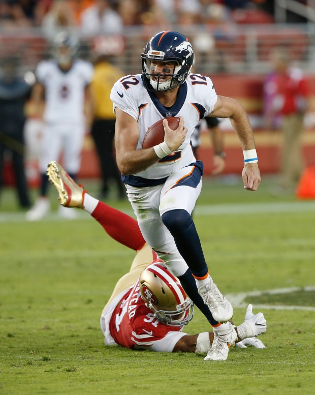 Denver Broncos quarterback Paxton Lynch (12) breaks a tackle by San Francisco 49ers defensive end Arik Armstead (91) on a keeper in the second quarter at Levi's Stadium on Saturday, Aug. 19, 2017, in Santa Clara, Calif. (Jim Gensheimer/Bay Area News Group)