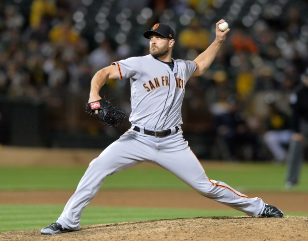 San Francisco Giants closing pitcher Josh Osich (61) delivers a pitch in the ninth inning of their baseball game against the Oakland Athletics at the Oakland Alameda Coliseum in Oakland, Calif., on Tuesday, Aug. 1, 2017. (Doug Duran/Bay Area News Group)