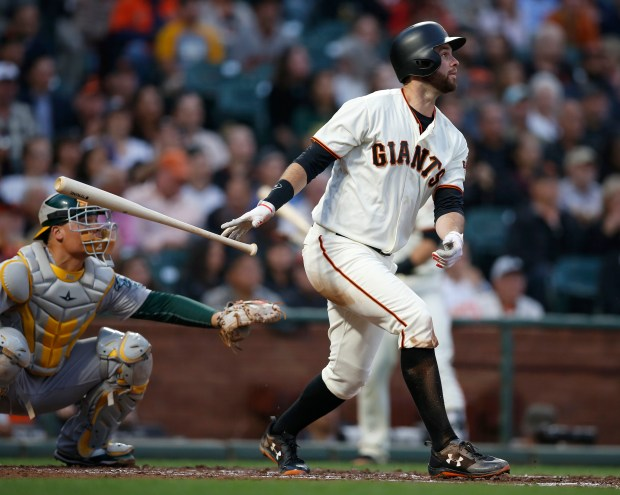 San Francisco Giants' Brandon Belt (9) hits a two-run home run against the Oakland Athletics in the second inning at AT&T Park in San Francisco, Calif. on Thursday, August 3, 2017. (Nhat V. Meyer/Bay Area News Group)