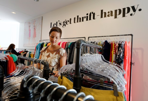 Kelly Thistle from Walnut Creek, a fan of the online store, shops at the newly opened ThredUp store in downtown Walnut Creek, Calif., on Thursday, Aug. 17, 2017. Like Amazon, ThredUp, an online thrift store, is getting into the brick-and-mortar business. The Walnut Creek store that opened Thursday is the second physical location. (Laura A. Oda/Bay Area News Group)
