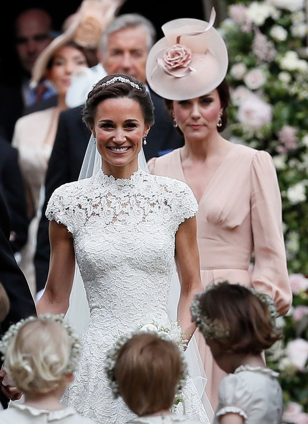 ENGLEFIELD, ENGLAND - MAY 20: Catherine, Duchess of Cambridge, right, follows the bride, her sister Pippa Middleton, after her wedding to James Matthews at St Mark's Church on May 20, 2017 in Englefield, England.Middleton, the sister of Catherine, Duchess of Cambridge married hedge fund manager James Matthews in a ceremony Saturday where her niece and nephew Prince George and Princess Charlotte was in the wedding party, along with sister Kate and princes Harry and William. (Photo by Kirsty Wigglesworth - Pool/Getty Images)