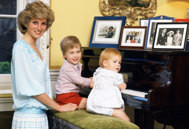DIANA, 7 YEARS -- Pictured: (l-r) -- Diana, Princess of Wales with her sons, Prince William and Prince Harry, at the piano in Kensington Palace (Photo by: Tim Graham/Getty Images)