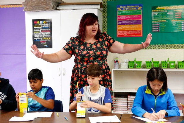 Colleen Nelson, part-time sixth-grade math teacher, instructs her students during the first day of school at Sunol Glen Elementary School in Sunol, California, on Wednesday, August 9, 2017. Students, left to right, are Samir Ahmed, Octavius Stockwell, and Natalie Lai. (Gary Reyes/ Bay Area News Group)