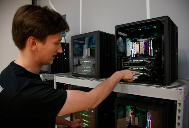 Brandon Ogle, an engineer at Standard Cognition, works on the technology that power their new demonstration store, Thursday, Aug. 24, 2017, in Santa Clara, California. (Karl Mondon/Bay Area News Group)