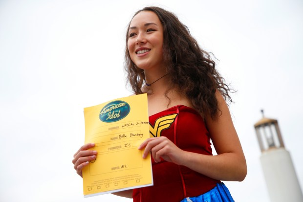 "Bella Bromberg ,16, of San Rafael holds a ""Golden Ticket"" that lets her advanced to the next round of auditions for the new American Idol televison show on Sunday, Aug. 20, 2017, in Oakland, Calif. Thousands of people lined up in Jack London Square to audition for a new American Idol show. (Aric Crabb/Bay Area News Group)"