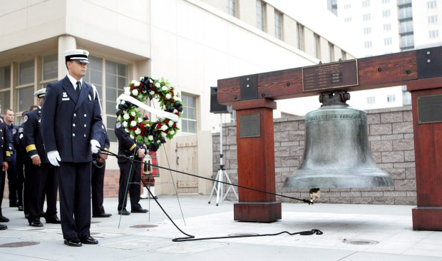 The firefighters' memorial bell is rung during a remembrance ceremony in 2008. (Mercury News)