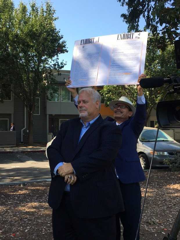A supporter of Van Le deliberately stands in front of Councilman Tam Nguyen during a press conference Tuesday
