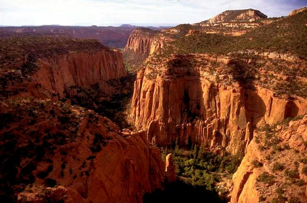FILE- In this undated file photo, the Upper Gulch section of the Escalante Canyons within Utah's Grand Staircase-Escalante National Monument features sheer sandstone walls, broken occasionally by tributary canyons. Interior Secretary Ryan Zinke said he's recommending that none of 27 national monuments carved from wilderness and ocean and under review by the Trump administration be eliminated, including the Grand Staircase-Escalante National Monument. (AP Photo/Douglas C. Pizac, File)
