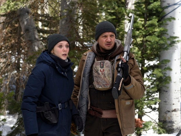 "This image released by The Weinstein Company shows Elizabeth Olsen, left, and Jeremy Renner in a scene from ""Wind River."" (Fred Hayes/The Weinstein Company via AP)"