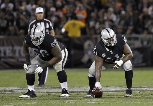 Oakland Raiders' Gabe Jackson (66) and Rodney Hudson (61) against the Denver Broncos during an NFL football game in Oakland, Calif., Sunday, Nov. 6, 2016. (AP Photo/Marcio Jose Sanchez)