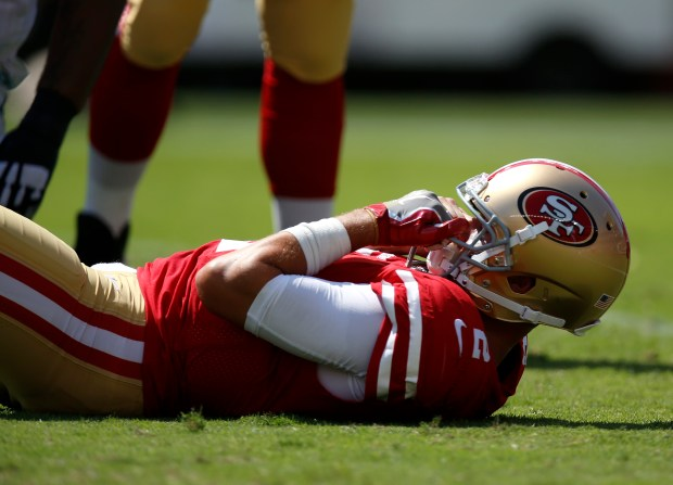 San Francisco 49ers starting quarterback Brian Hoyer (2) sits on the field after being sacked against the Carolina Panthers in the second quarter of their NFL game at Levi's Stadium in Santa Clara, Calif., on Sunday, September 10, 2017. (Nhat V. Meyer/Bay Area News Group)