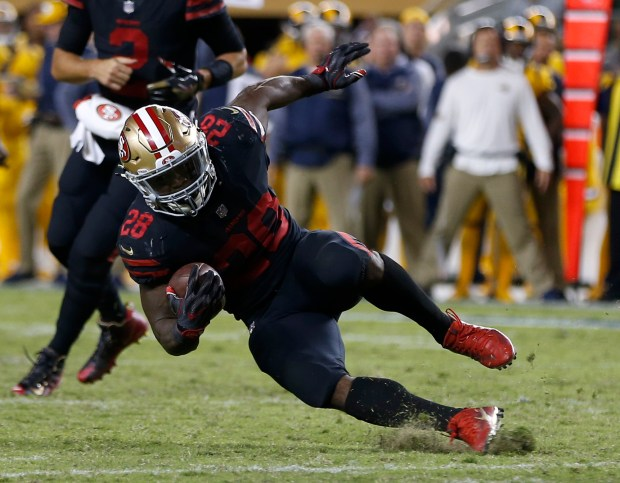 San Francisco 49ers' Carlos Hyde (28) slips on the grass on a run against the Los Angeles Rams in the fouth quarter of their NFL game at Levi's Stadium in Santa Clara, Calif., on Thursday, September 21, 2017. (Nhat V. Meyer/Bay Area News Group)
